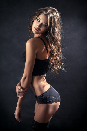 fetishes: pretty girl in lingerie looking back on her buttocks