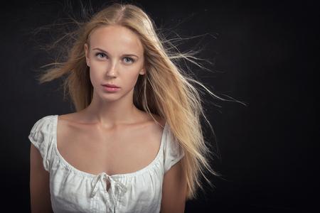 beautiful sad: sad blond girl on black background