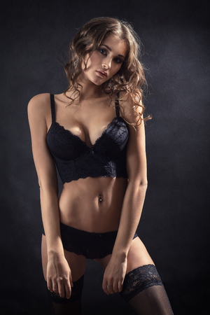 fetishes: luxury woman in lingerie on black background