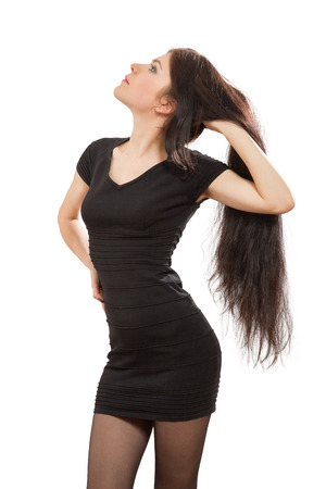 sexy pose: young woman showing her long hair isolated on white background