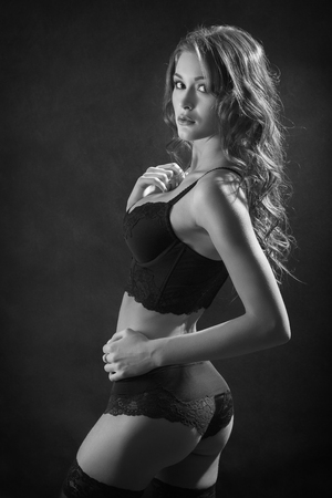 fetishes: beautiful woman with slim body in lingerie, monochrome image Stock Photo