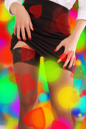 hosiery: girl showing her stockings on multicolor background