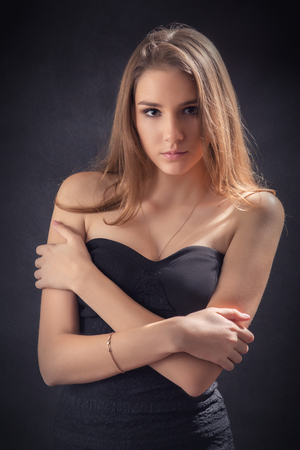 elegance fashion girls look sensuality young: serious woman portrait with naked shoulders