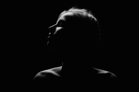 female profile on black background monochrome image with copyspace