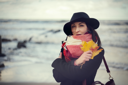 embraced: sad pensive woman embraced herself at sea background