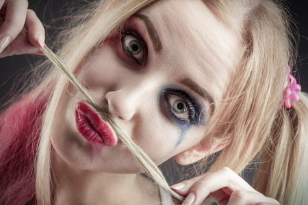 smeared: fun blond girl making fake mustache from her hair Stock Photo