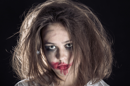 pretty fun crazy girl with fluffy hair and smeared cosmetics on black background Stock fotó