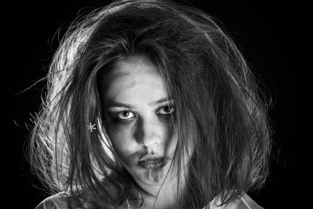 pretty fun crazy girl with fluffy hair and smeared cosmetics on black background, monochrome Stock fotó