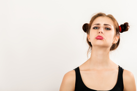 rudeness: offended fun girl on white background with copy space