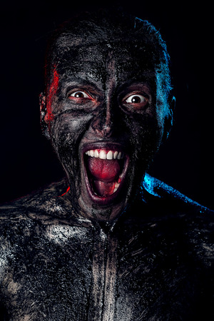 angry dirty zombie attack on black background Stock Photo