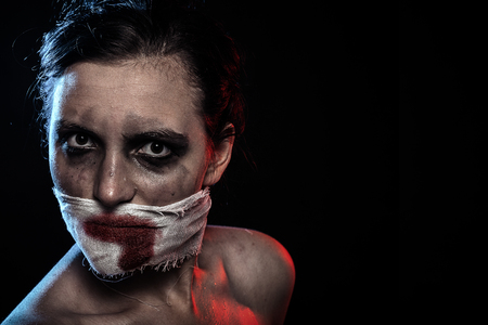 woman with wounded face and smeared cosmetics looking at camera Stock Photo