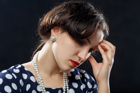 sad pensive woman on black background with copy space