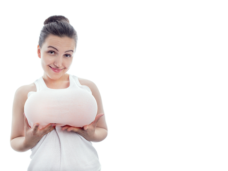 young woman shows her big fake on white background with copy space