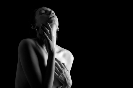 sensual nude young aroused woman on black background Standard-Bild - 109991016