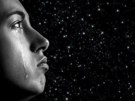 sad woman crying, looking up on stars background with copy space, closeup portrait, profile view, monochrome Stock Photo