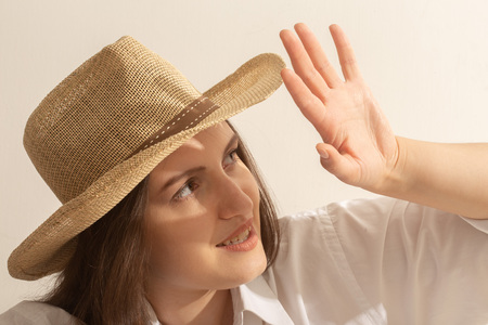 happy young woman in sunhat under sunlight looking at sun smiling Stock Photo