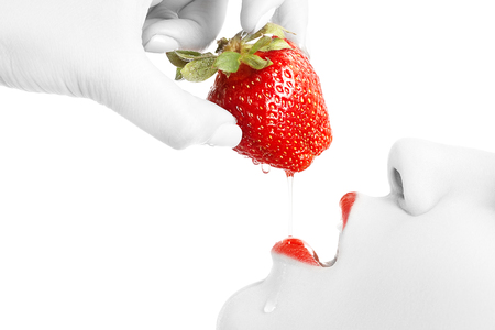 young sensual woman with open mouth and juicy strawberry on white background isolated profile view 写真素材