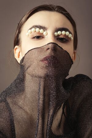 young woman with black veil and luxury makeup on gray background looking at camera Banque d'images - 124702418