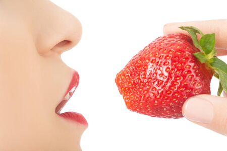 young woman with open mouth and juicy strawberry on white background isolated profile view