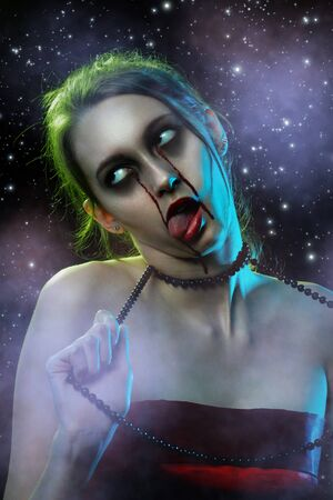 young woman with halloween blood tears makeup strangled herself with her necklace. show tongue, stars background