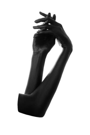 female hands painted in black color isolated on white background, monochrome