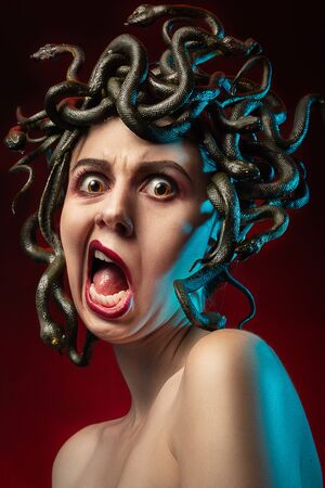 medusa gorgon with shoulders looking at camera on red background, screaming