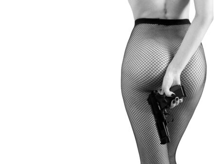 unrecognizable female body in fishnet tights with gun in hand isolated on white background with copy space, monochrome