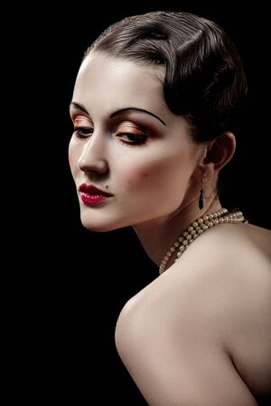 young luxury woman in retro vintage style on black background Reklamní fotografie