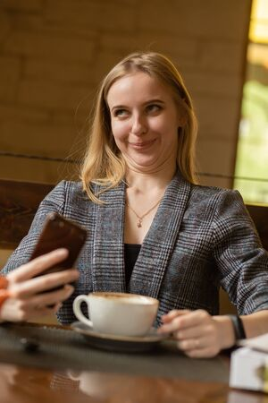 fun blond young confused woman with Dawns syndrome grimacing smiling, taking a selfie 版權商用圖片
