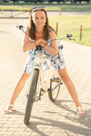 cute young woman cyclist standing looking at camera, smiling 版權商用圖片