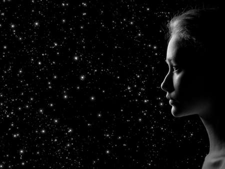 profile of young pensive woman on stars background with copy space, monochrome