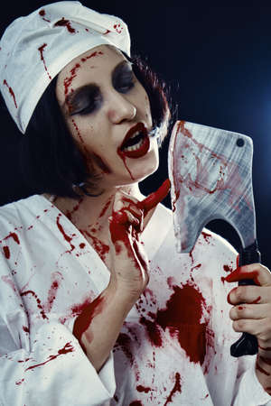 gloomy bloody woman doctor with an ax on a black background