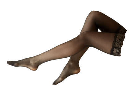 beautiful female legs in black stockings isolated on white background side view closeup
