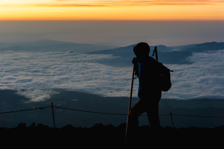 gather: Hikers gather during sunrise on the Mt. Fuji .