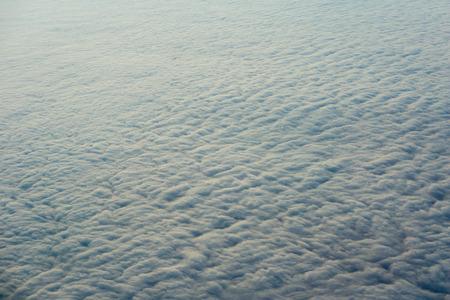 seen: Clouds, sun, sky as seen through window of an aircraft Stock Photo