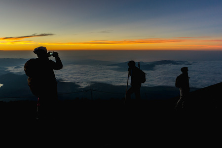 gravelly: Hikers gather during sunrise on the Mt. Fuji .
