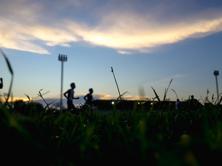 Blurry Silhouette of starting blocks in track and field. Stock Photo