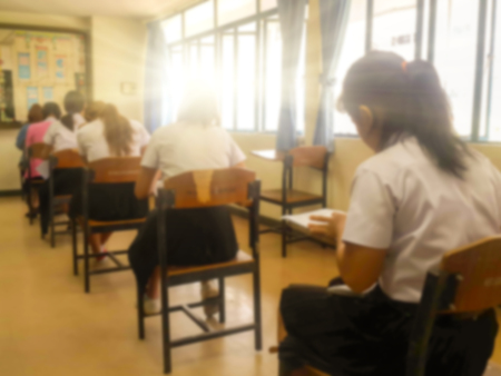 answer: Blurry view of study chairs in classroom of university or campus Stock Photo