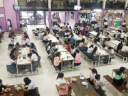 dining table and chairs: Blur image Canteen Dining Hall Room, A lot of people are eating food in University canteen blur background