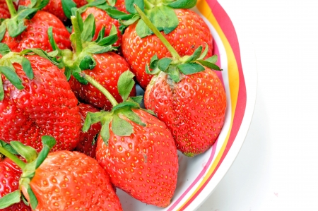 isolated strawberries in bowl