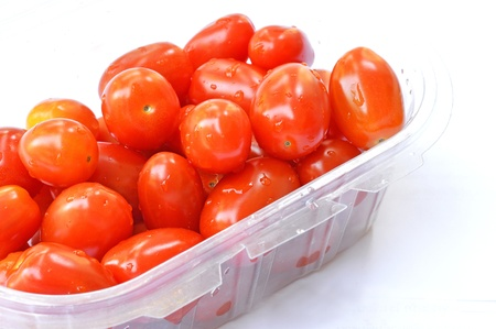 isolated tomato in plastic box