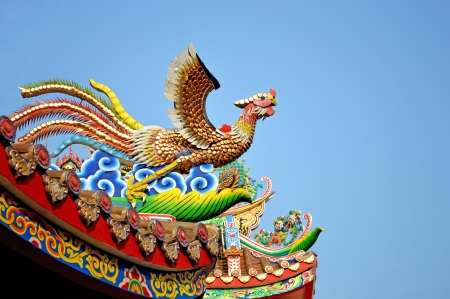 The golden Phoenix on the roof of joss house photo