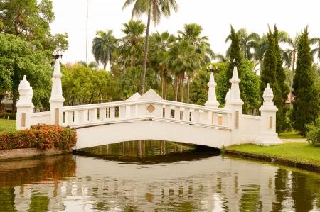 white bridge in asian garden