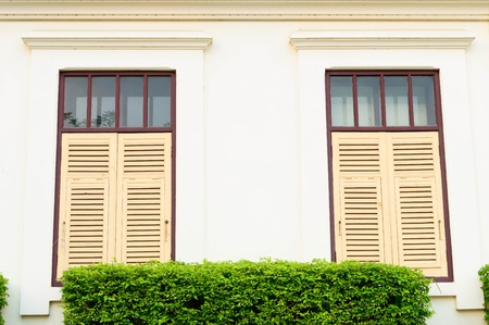 two Thai classic windows on classic buildings in Chiangmai, Thailand Stock Photo