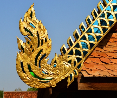The Old wooden naga on roof in Lamphun, Thailand Stock Photo - 18656219