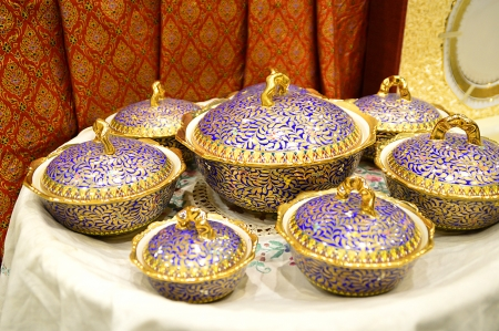 name of Thai porcelain with designs in five colours photo