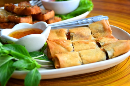 Spring Rolls - Fried vegetable spring rolls served with sweet chili sauce