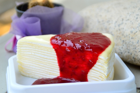 white layer cake with strawberry jam topping