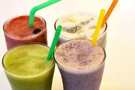 Fresh fruit juices isolated on white background Stock Photo