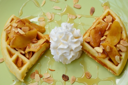 almonds waffle with wipcream and cyrup for breakfast photo